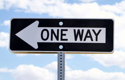 One way road sign. Against clouds Stock Photos