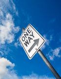 One way road sign on cloudy sky background. One way road sign on blue sky background Stock Images