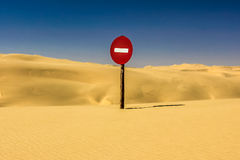 Warning sign in a desert Royalty Free Stock Photos