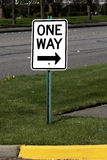 One way sign. A one way sign on a post in a public street Royalty Free Stock Photography