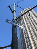 One Way Sign. A one-way sign with a huge skyscraper in the backdrop, in New York, USA Royalty Free Stock Photography