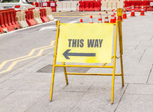One way sign against on the road background. Stock Images