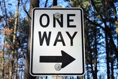 One Way Sign With Arrow And Black Border In Forest Stock Photo