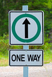 A one way sign with arrow indicating straight ahead Stock Image