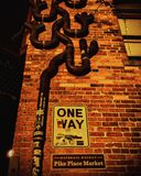 One Way. A one way sign on a brick wall in Seattle Stock Images