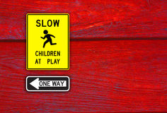 One way sign and children sign Stock Photo