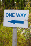 A one way sign with an direction arrow Royalty Free Stock Image