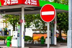 One way sign on the gas station. Industry and energy concept with petrol station. One way sign on the gas station. Industry and energy concept with petrol stock image