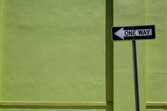 One Way Sign & Green Wall Royalty Free Stock Photography