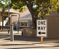 One Way Sign in a Street stock photo