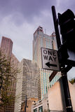 One Way sign and tall Chicago buildings. One Way traffic sign and tall buildings in Chicago, Illinois, United States. Street view looking up Royalty Free Stock Image
