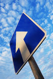 One way sign under blue sky Stock Photos