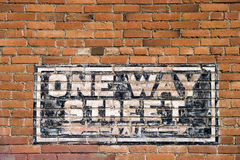 One Way Street Traffic Sign. One Way Street and Exit sign painted on brick wall Royalty Free Stock Photography
