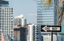 One Way traffic sign with city skyline on background.  Royalty Free Stock Photos
