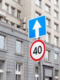 One way traffic sign and speed limitation sign stock photo