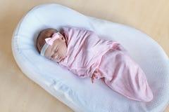 One week old newborn baby girl sleeping wrapped in blanket Royalty Free Stock Photo