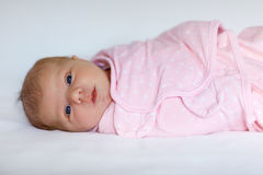 One week old newborn baby girl wrapped in blanket Stock Photography
