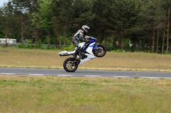 One wheel racing. Motor bike on the track Royalty Free Stock Photo