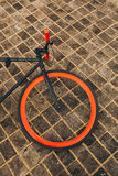 One wheel of red bycicle on floor Royalty Free Stock Image