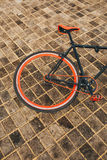 One wheel of red bycicle on floor Stock Photography