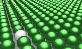 One white  ball in many green  balls Stock Photography