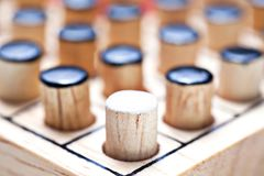 The one white in black of  Wooden Revessi Othello game close up. Of Different wood stick , Business concept, Selective focus Royalty Free Stock Photography