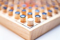The one white in black of  Wooden Revessi Othello game close up. Of Different wood stick , Business concept, Selective focus Royalty Free Stock Photos