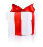 One White boxs tied Red satin ribbon bow. On white background Stock Photo
