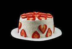 One white cake decorated with slices of strawberries Royalty Free Stock Images
