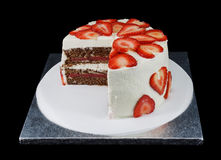 One white cake decorated with slices of strawberries Stock Photos