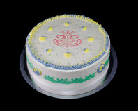 One white cake with decorations in different colors Stock Image
