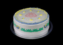 One white cake with decorations in different colors Stock Photos