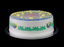 One white cake with decorations in different colors Royalty Free Stock Photo