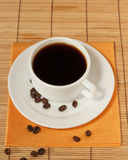 One white coffee cup and saucer on the table Stock Image