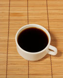 One white coffee cup on the table Royalty Free Stock Photos