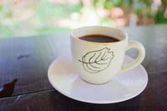 One white cup of aromatic coffee Stock Photos