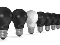 One white light bulb in row of many black ones Stock Image