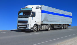 One white lorry with trailer. Moving over blue sky on the road Royalty Free Stock Images