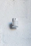 One white motion sensor on white wall Stock Photography