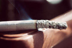 One white steaming smoldering cigarette Stock Photography