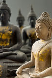 One White Stone Buddha and Three Black statue Royalty Free Stock Images