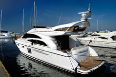 One white yacht in harbour. One white yacht is moored in harbour Royalty Free Stock Photos