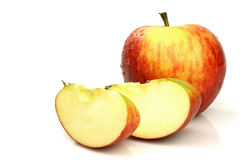 One whole apple and some pieces Royalty Free Stock Images