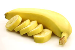One whole banana and some pieces Royalty Free Stock Images