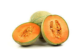 One whole cantaloupe melon and two halves Stock Images