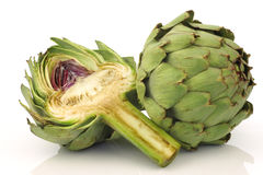 One whole and cut artichoke Royalty Free Stock Images