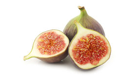 One whole and a cut fig (Ficus carica) Stock Photo