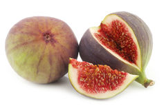 One whole and a cut fig (Ficus carica) Stock Image