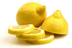 One whole and a cut lemon Stock Photography