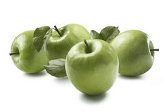 One whole green apple and two halves isolated on white Stock Photography